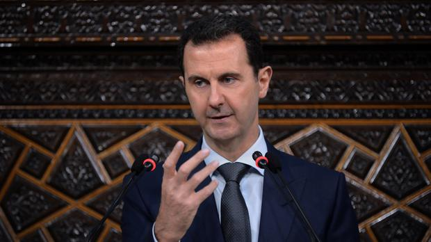Bashar Assad addresses the newly elected parliament in Damascus (SANA/AP)