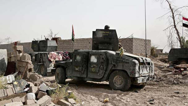 Humvees on the edge of the Shuhada neighbourhood in Islamic State-held Fallujah, Iraq, just before Iraqi special forces pushed into the district (AP)