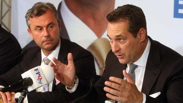Norbert Hofer, presidential candidate for Austria's right-wing Freedom Party, and Heinz-Christian Strache, head of the FPOE, attend a news conference in Vienna, Austria (AP)