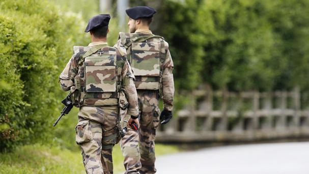 French soldiers patrol in Evian (AP)