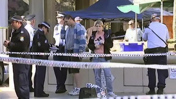 A screengrab of police investigating the attack at a Sydney shopping mall. (Australian Broadcasting Corporation via AP)