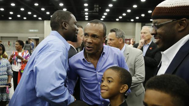 Sugar Ray Leonard is greeted by former two-time heavyweight world champion Hasim Rahman before Muhammad Ali's Jenazah, a traditional Islamic Muslim service, in Freedom Hall, Louisville (AP)