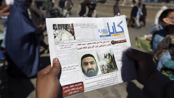 An Afghan newspaper with a story about the former leader of the Afghan Taliban, Mullah Akhtar Mansoor, who was killed in a US drone strike in Kabul last month (AP)