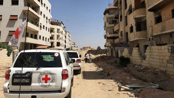 A humanitarian aid convoy arrives in Daraya, Syria (International Committee of the Red Cross/AP)