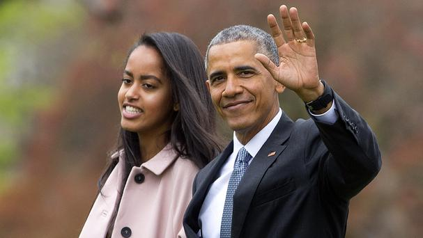 US president Barack Obama with his daughter Malia (AP)