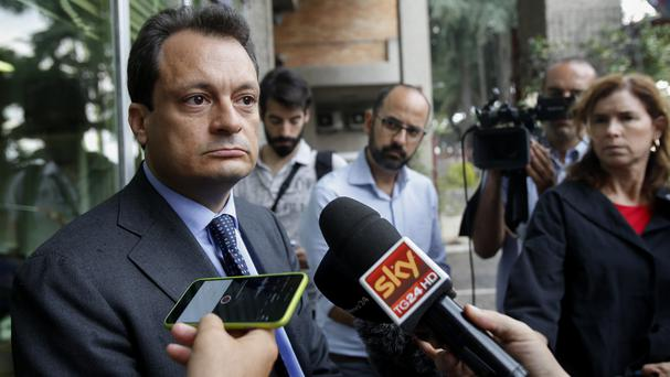 Lawyer Michele Calantropo talks to journalists outside Rebibbia penitentiary in Rome (AP)
