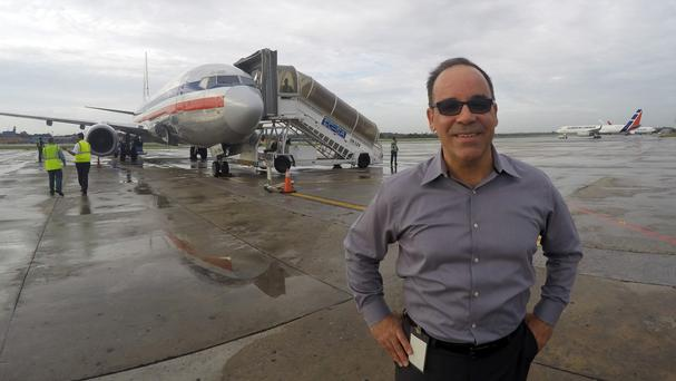 Galo Beltran, Cuba country manager for American Airlines, poses for a picture near a charter flight in Havana (AP)