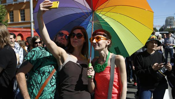 Ukrainian gay rights activists pose for a selfie as they take part in a event in Kiev, Ukraine (AP)