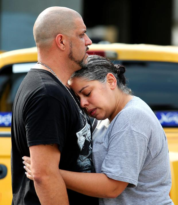 Ray Rivera, a DJ at Pulse, is consoled by a friend. Photo: AP