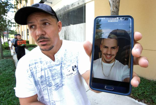 Angel Mendez at the Orlando Regional Medical Centre tries to get information about his missing brother Jean, who was in the club. Photo: AP