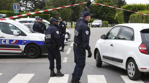 Police officers at the scene in Magnanville, west of Paris (AP)