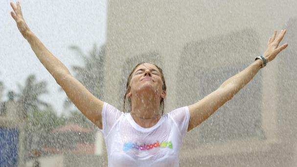 Actress Sienna Miller experiences the full force of India's monsoon season in Mumbai