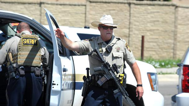 Armed police at the scene at a Wal-Mart store in Amarillo, Texas (Michael Schumacher/Amarillo Globe News/AP)