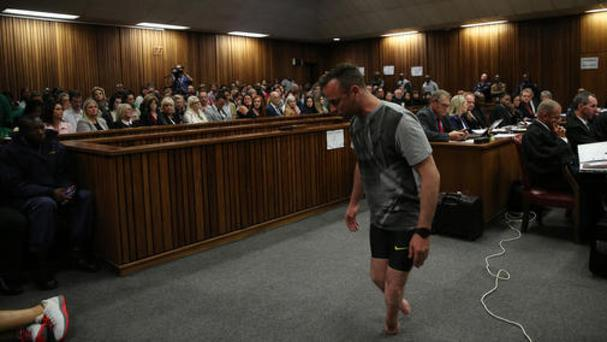 Oscar Pistorius removed his prosthetic legs during his sentencing hearing in the High Court in Pretoria (AP)