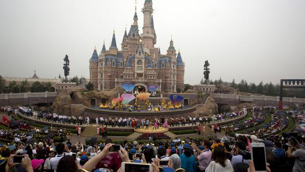 Performers take to the stage during the opening ceremony for the Disney Resort in Shanghai (AP)
