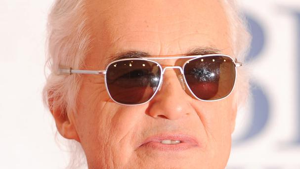 Led Zeppelin star Jimmy Page played air guitar in court in Los Angeles