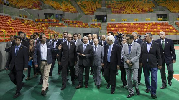 Brazil's interim president Michel Temer, centre, walks with officials during a visit to the Olympic Park in Rio (AP)