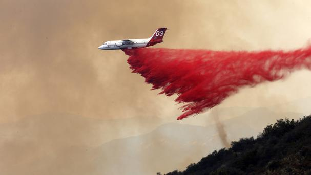 A DC-10 tanker drops fire retardant on a wildfire near Santa Barbara (AP)