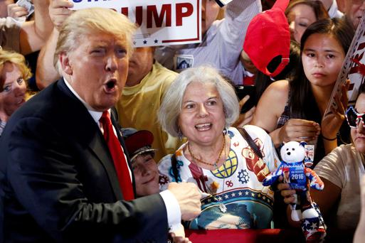Republican US Presidential candidate Donald Trump greets supporter Diana Brest in the crowd at a campaign rally in Phoenix, Arizona.