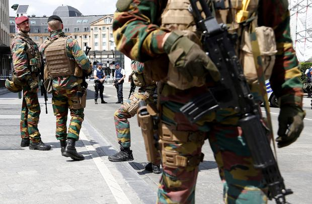 Belgian soldiers stand guard at Brussels Central Station