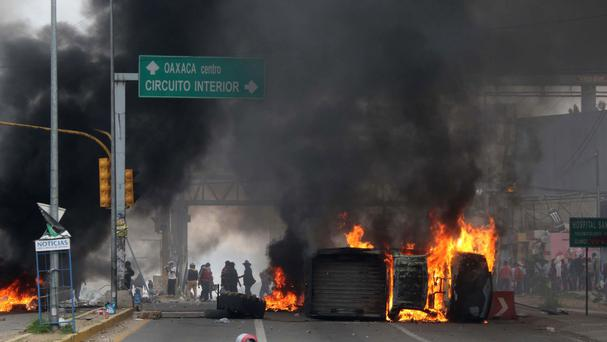 Protesting teachers block a federal highway in the state of Oaxaca, near the town of Nochixtlan (AP)