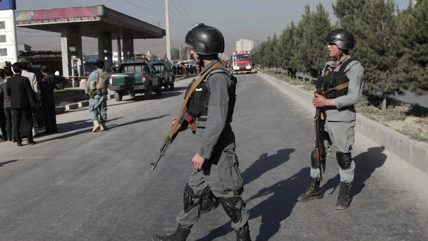Afghan police soldiers inspect the site of a suicide attack in Kabul in which a number of Nepalese security guards were killed (AP)