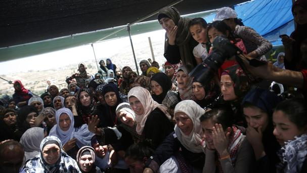 Mourners at the West Bank funeral of Palestinian Aref Jaradat, who was injured in clashes with Israeli security forces (AP)