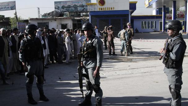 Afghan police soldiers inspect the site of a suicide attack in Kabul in which Nepalese security guards were killed (AP)