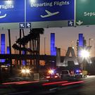 Both men were arrested when one tried to board a commercial airliner at Los Angeles International Airport for a flight to Turkey