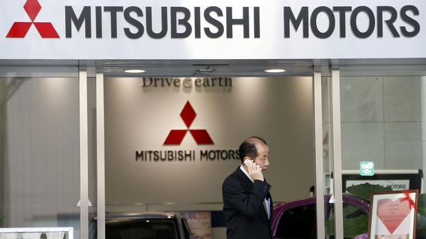 Mitsubishi, which recently acknowledged it inflated mileage on its models, is forecasting losses for the financial year to March 2017 (AP)