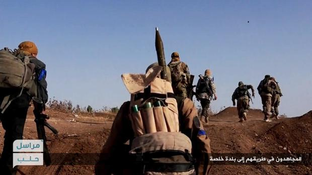 Syria's al Qaida-linked Nusra Front fighters moving forward to fight against Syrian troops and pro-government gunmen in Aleppo (AP)