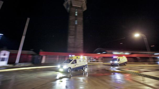 Two ambulances enter the airport to pick up two workers from the US South Pole Amundsen-Scott in Punta Arenas, Chile (AP)