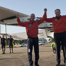 Pilots Bertrand Piccard and Andre Borschberg celebrate the landing of the solar-powered plane at San Pablo airport in Seville, Spain (AP)