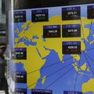 A screen showing the world stock market index at the Hong Kong Stock Exchange (AP)