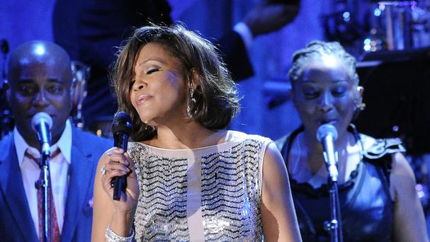 A judge has blocked the sale of an Emmy Award won by Whitney Houston that the singers family had put up for auction. (AP)