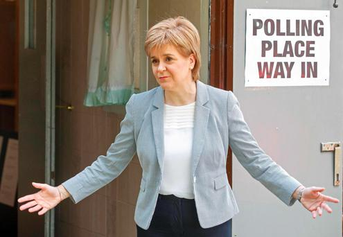Nicola Sturgeon reacts as leaves after voting at a polling station at Broomhouse Community Hall in east Glasgow. Photo: Getty