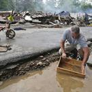 The deluge destroyed or damaged more than 100 homes and knocked out power to tens of thousands of homes and businesses. (AP)