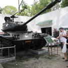 Tourists visit the War Remnants Museum in Ho Chi Minh City, Vietnam