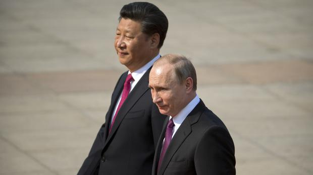 Chinese President Xi Jinping (left) walks with Russian President Vladimir Putin during a welcoming ceremony at the Great Hall of the People in Beijing (AP)