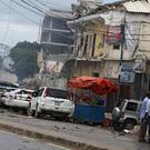 Security forces examine the scene after a bomb attack on Nasahablod Hotel in Mogadishu, Somalia (AP)