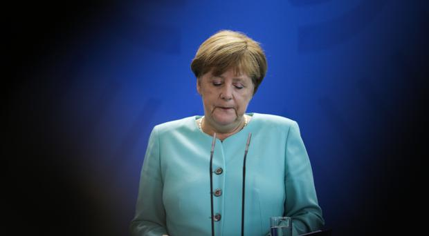 German Chancellor Angela Merkel voiced regret about the Brexit vote, but is to meet her French and Italian counterparts on Monday to discuss the future of the EU (AP)