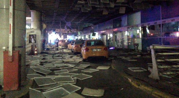 An entrance of the Ataturk Airport in Istanbul after the explosions (DHA via AP)