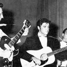 Elvis Presley on tour in 1957 with Scotty Moore, left, and Bill Black on the stand up bass (AP)