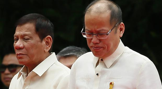 New president Rodrigo Duterte, left, with outgoing president Benigno Aquino during the inauguration ceremony (AP)