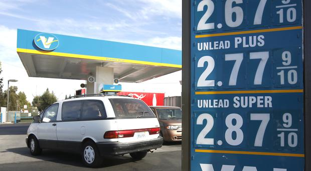 Petrol prices on display at a Valero filling station in Sacramento (AP)
