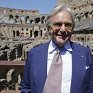 Tod's founder Diego Della Valle poses inside the Colosseum after the first stage of the restoration work was completed (AP)