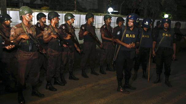 Bangladeshi security personnel cordon off an area after an attack on a restaurant in Dhaka, Bangladesh (AP)