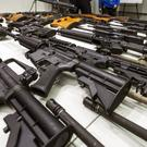 California governor Jerry Brown signed six stringent gun-control measures that will require people to turn in high-capacity magazines and background checks for ammunition sales (AP)