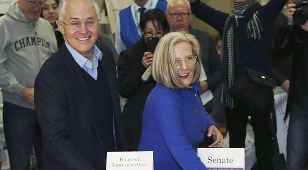 Prime minister Malcolm Turnbull and his wife Lucy cast their votes at the Double Bay school in Sydney (AP)