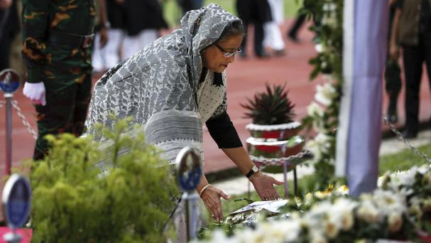 Prime minister Sheikh Hasina offers a tribute to the victims of the attack (AP)